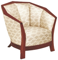 Upholstered Ascot lounge chair crafted of cherry wood by Martin Pierce Custom hardware